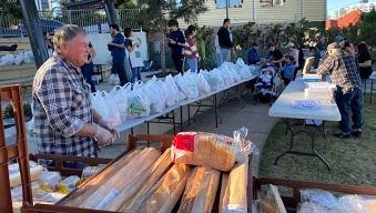 Volunteers at a food drive in West End