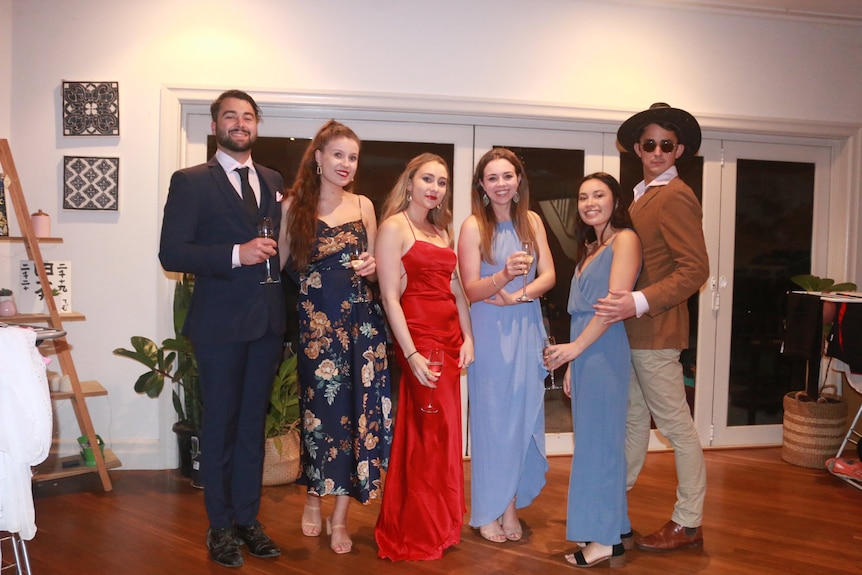 Sarah and her housemates wearing fancy attire for her birthday in lockdown.