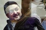Rustam Makhmudov is escorted into court.