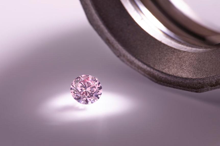 A pink diamond catches the light.