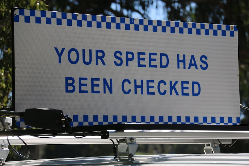 A sign saying 'Your speed has been checked'.