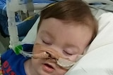 Alfie Evans hooked up to life support in hospital.