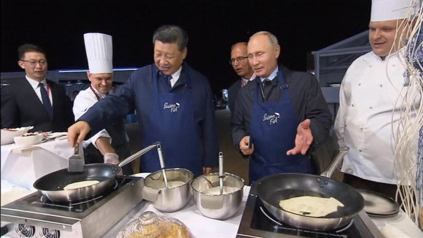 Xi Jinping and Vladimir Putin show off friendship making pancakes and drinking vodka