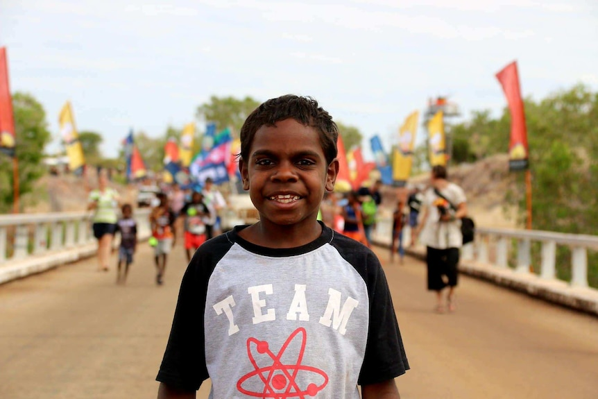 Young boy joins 50th anniversary re-enactment of the Wave Hill walk-off at Kalkarindji.