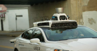 A car with self-driving sensors on the roof.