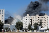 Building housing media in Gaza collapses