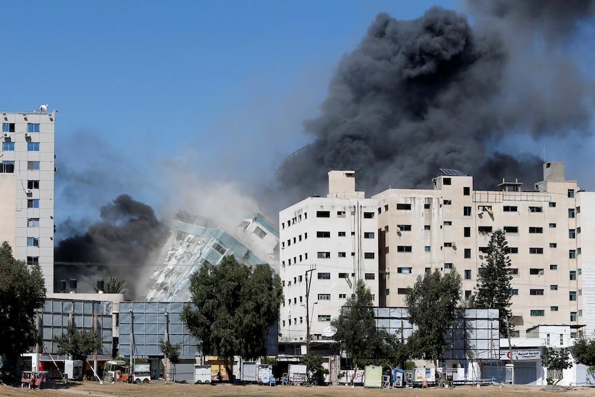 Building housing media in Gaza collapses