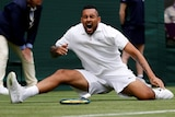 Nick Kyrgios screams in pain as he falls on the Wimbledon grass.