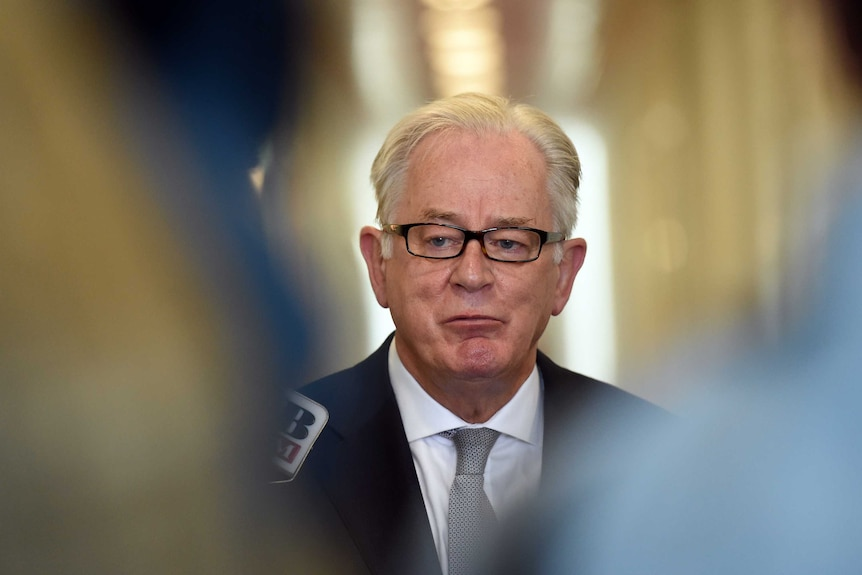 Andrew Robb at a press conference