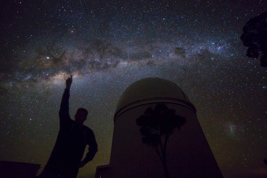 Night sky from Siding Spring with person and telescope