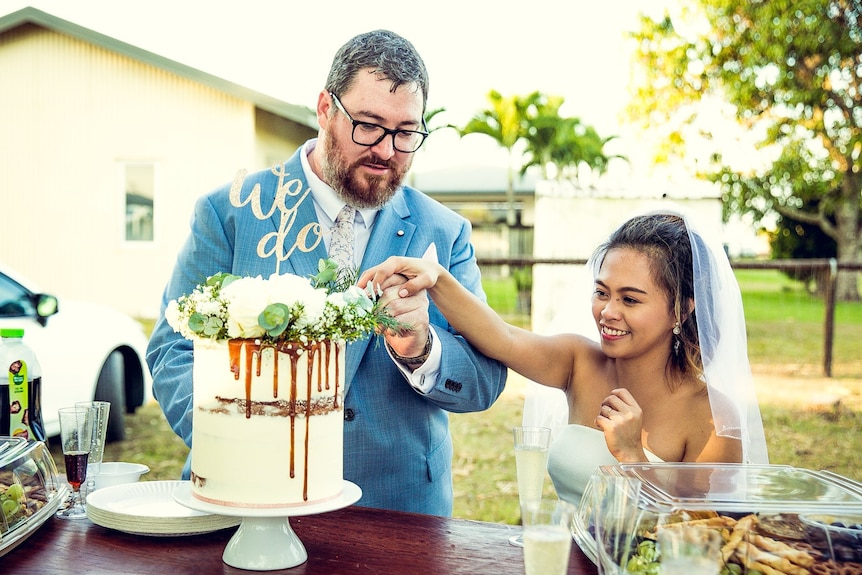 George Christensen and his wife April at their wedding