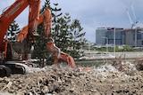 Earth movers on the Brisbane riverside demolition site