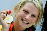 Leisel Jones poses with her gold medal