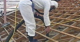 Mr Fluffy asbestos is removed from a Canberra house in the 1990s.
