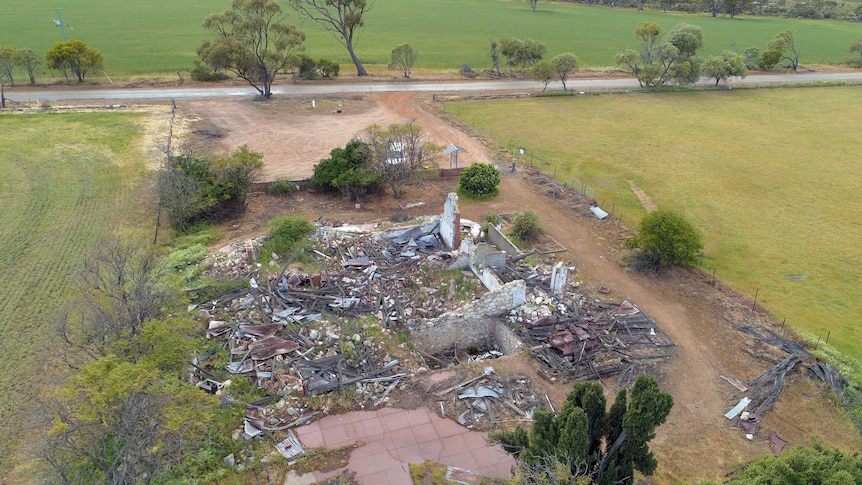 An aerial shot of a ruined house