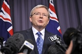 Prime Minister Kevin Rudd addresses a packed press conference in Canberra