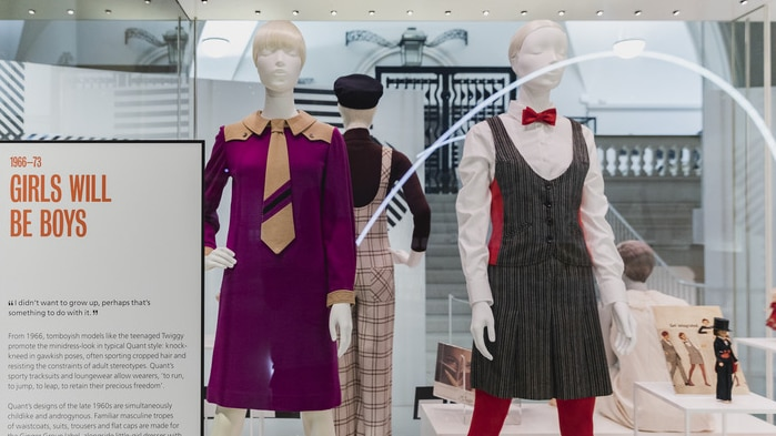 a mid shot of a number of dresses from the 1960s designed by Mary Quant and on display