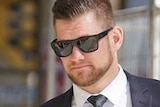 Police officer Lachlan Thomas Perhavec walks with his lawyer outside a Perth court.