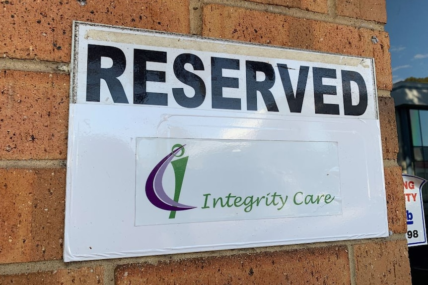 A white sign with the words 'reserved integrity care' displayed on it