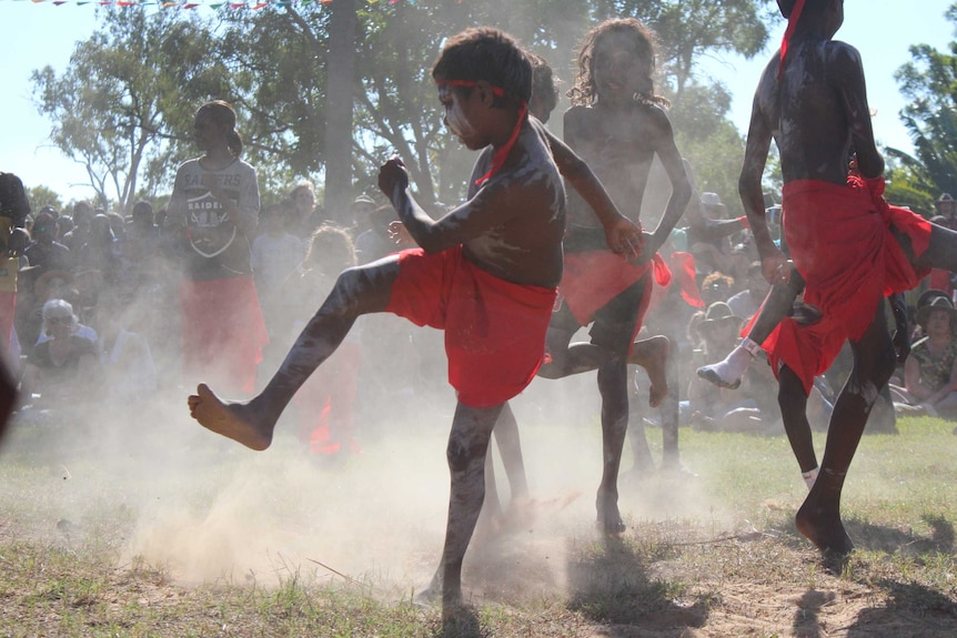 Children dance in traditional dress.