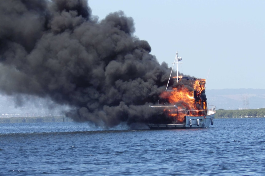 Burning yacht in Barker Inlet