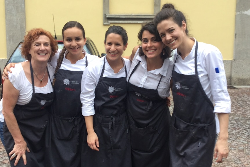 Kitchen hands, chefs (mainly from Osteria Francescana's kitchen) and Joanna Savill after service.