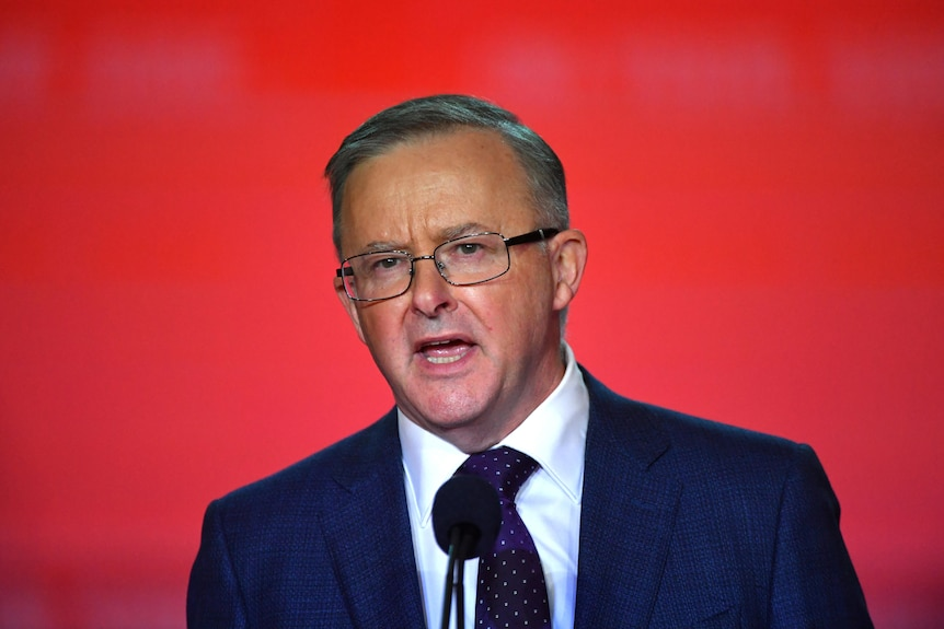 Anthony Albanese against a red background.