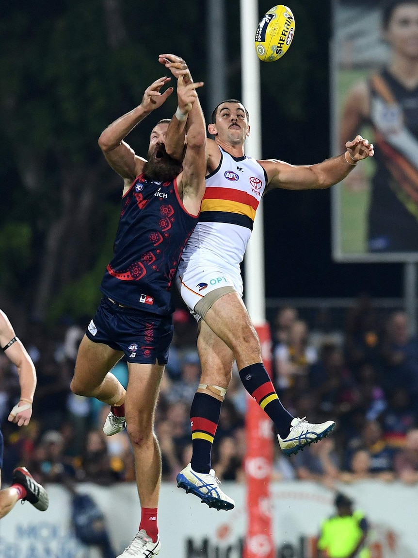 Taylor Walker (right) and Max Gawn contest for the ball as they collide in the air.