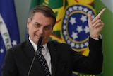 Brazil's President Jair Bolsonaro speaks during the launching ceremony of the Doctors for Brazil Program.