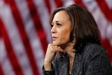 Kamala Harris in front of American flag