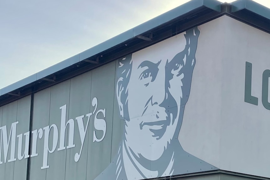 A sign outside a liquor store featuring the logo of Dan Murphy's.
