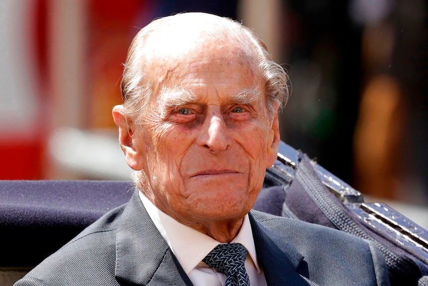 Prince Philip, the husband of Queen Elizabeth II, sits in a carriage in London.