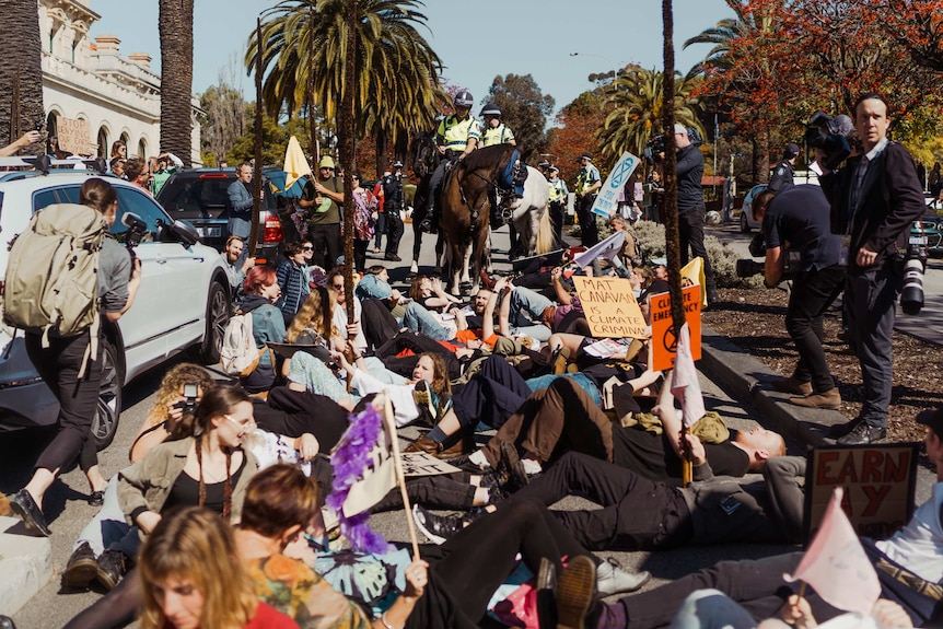Climate protesters lying on the road at Parliament House in Perth.