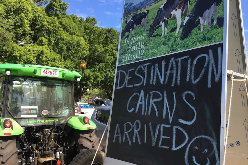 Tractor and trailer of Greg Dennis with writing announcing arrival into Cairns