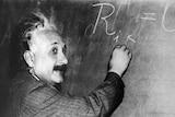 An undated photo of physicist Albert Einstein with blackboard