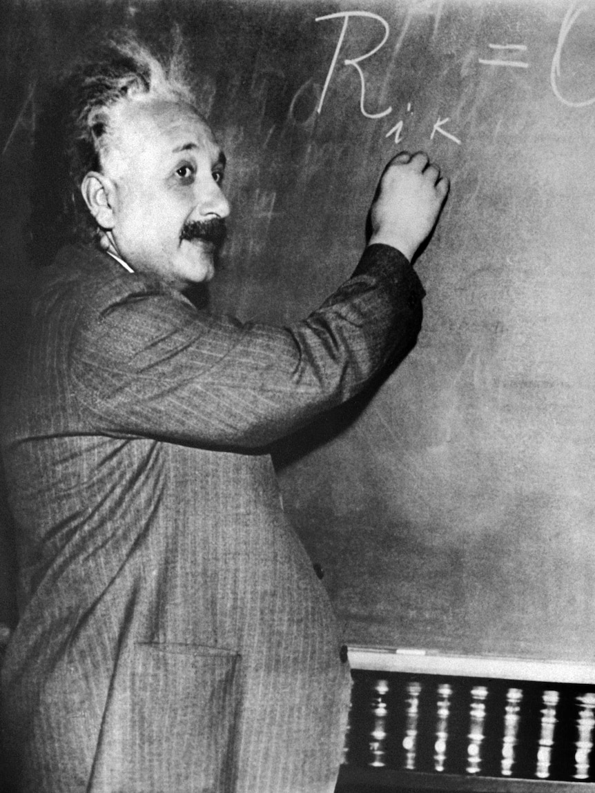 An undated photo of physicist Albert Einstein with blackboard
