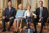 Prince Charles, Queen Elizabeth II, and Prince William seated, with Prince George standing on a small raised platform.