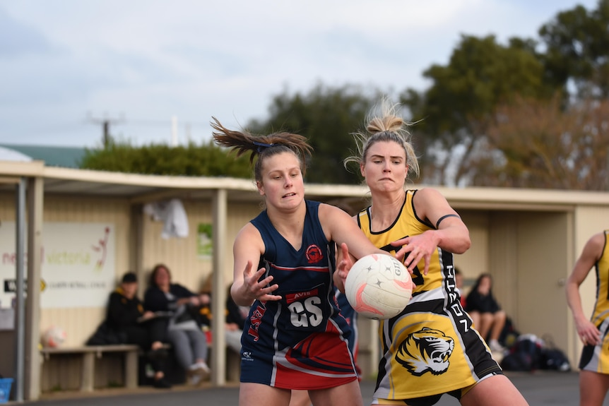 two women contest netball