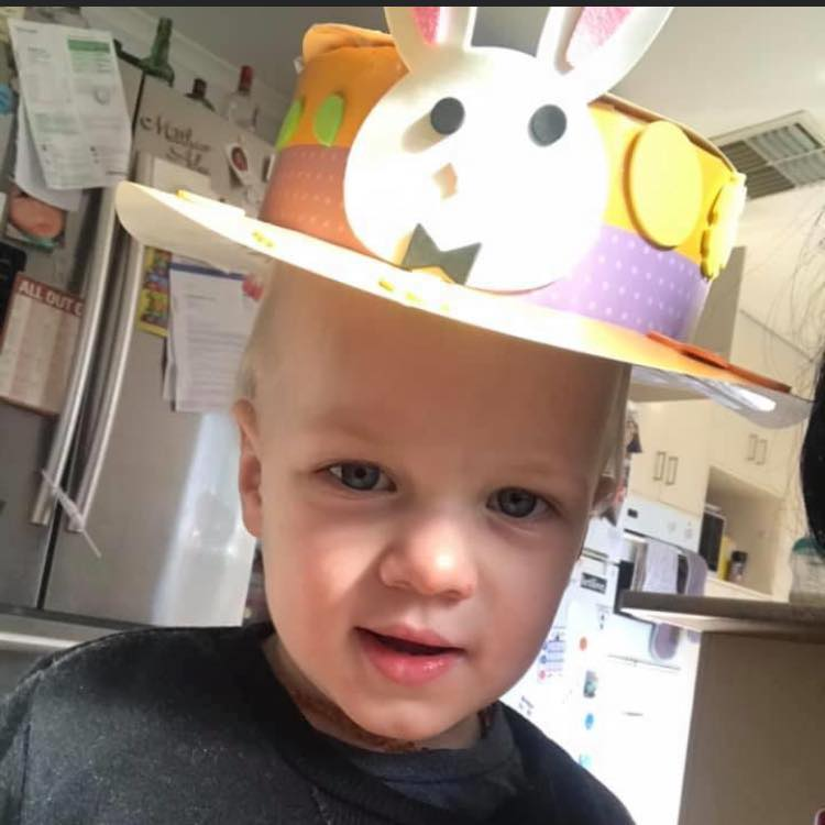 2 year old cute child with Easter hat on.