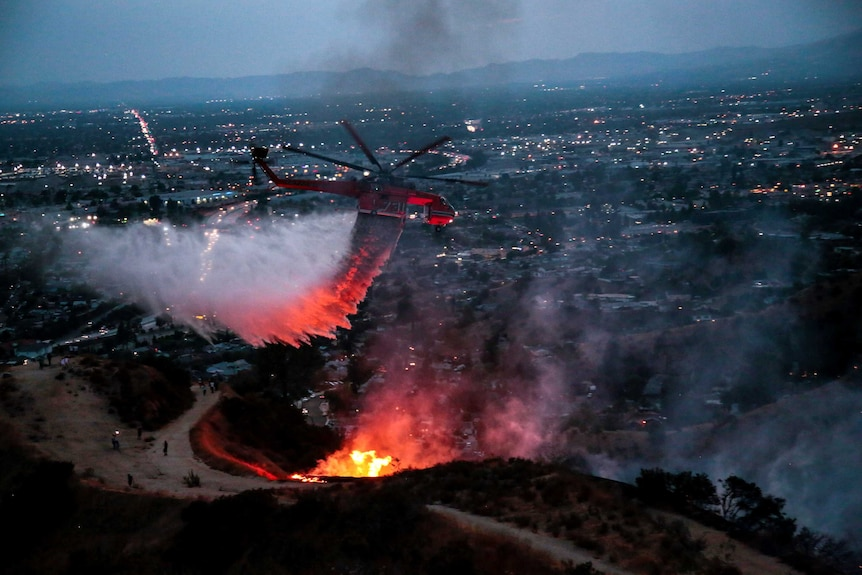 A water bomber tries to put out a fire in Burbank
