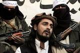 Pakistani Taliban commander Hakimullah Mehsud talks with a group of media representatives