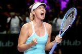 Maria Sharapova celebrates her WTA Finals victory over Simona Halep