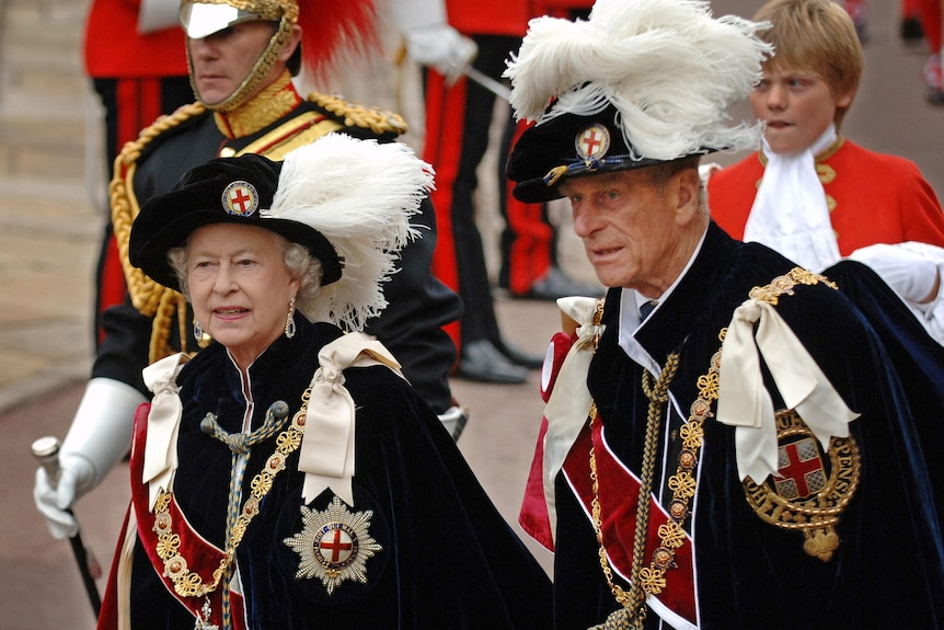Queen Elizabeth II (L) and Prince Philip arrive at St George's Chapel