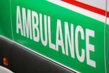 A close-up shot of the word 'ambulance' on the side of a St John WA ambulance.