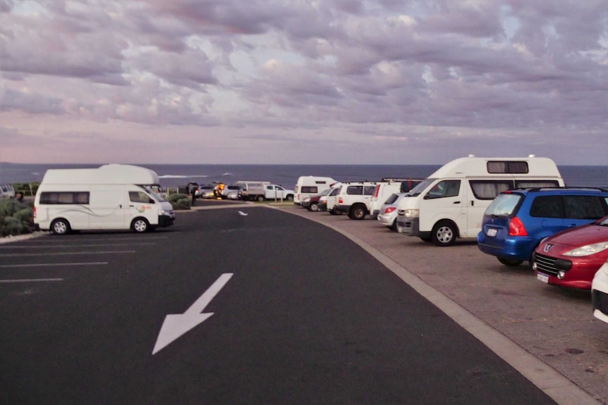 A line of cars in the Surfers Point carpark in Margaret River.