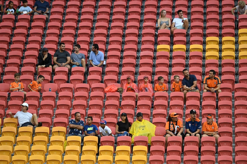 A sparsely occupied section of crowd at Lang Park for the Roar v Jets