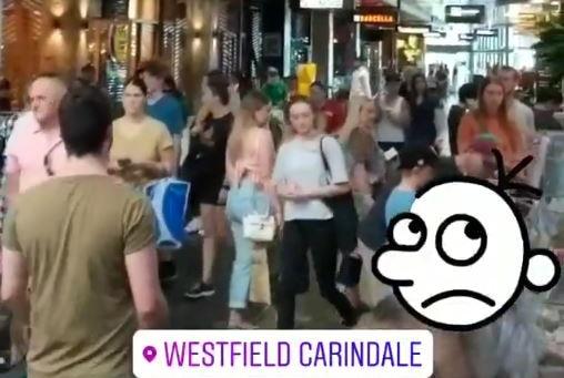 People walk through corridor at close proximity in shopping centre