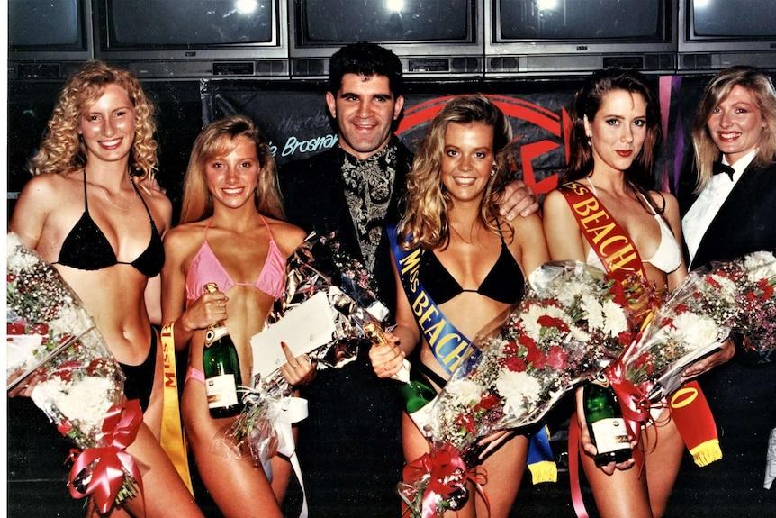 women in bikinis with flowers