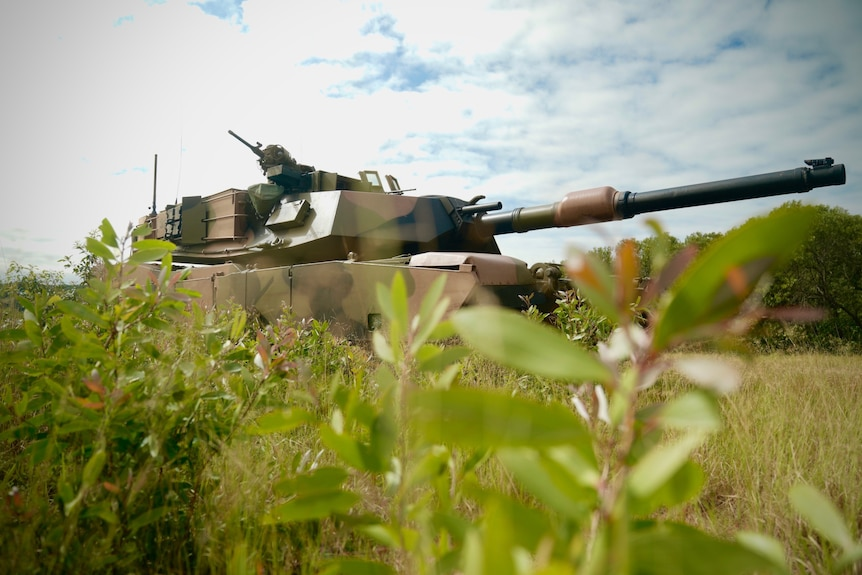 Australian Army M1A1 main battle tank camouflaged in the bush of North Queensland as part of a training exercise