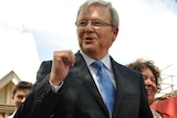 Kevin Rudd leaves church in Brisbane, with wife Therese Rein